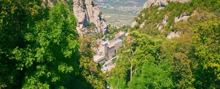Santa Maria de Montserrat Abbey in Monistrol de Montserrat, Catalonia, Spain. Famous for the Virgin of Montserrat. Benedictine monastery, the spiritual symbol and religious center of Catalonia and a center of pilgrimage for Catholics from around the world