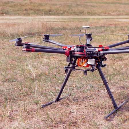 rc: RC copter on the ground. Oktokopter for photo and video.