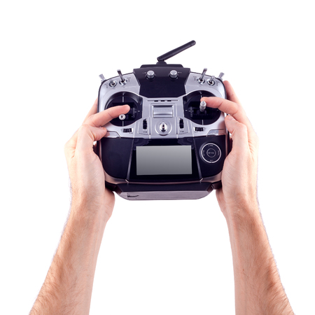 piloting: Remote control radio model in the hands of man on a white background.