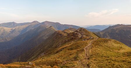 The mountain range in Ukraine. The road in the mountains. Travel along the ridge. Beautiful scenery highlands