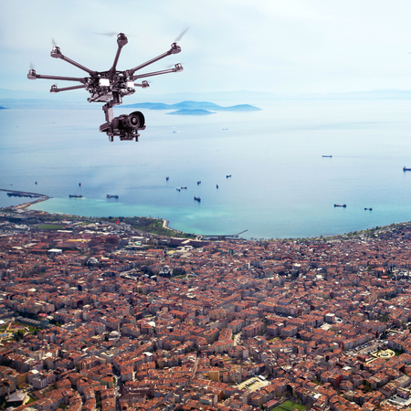rc: Copter shoots photos and videos to the city from a birds flight. RC copter at a height above the city. Stock Photo