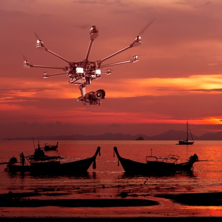 Flying copter with their gear on the background of a beautiful sunset. Stock Photo