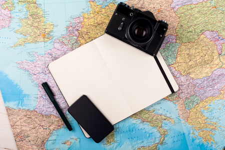 Outfit of traveler, photographer, student, teenager, young woman or guy. Different objects for planning vacation, trip or business trip on map background.