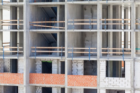 constructional: Monolithic frame construction of the building. Solid walls of concrete. Formwork for walls made of concrete. Construction of the building. Masonry walls and aerated concrete masonry walls