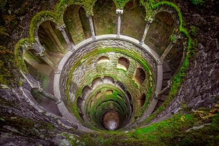 Initiation Wells. Sintra, Portugal. Spiral staircase with arched openings. Initiatic wells or inverted towers. Reklamní fotografie - 58765260