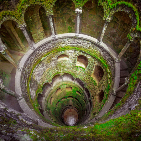 Initiation Wells. Sintra, Portugal. Spiral staircase with arched openings. Initiatic wells or inverted towers. Reklamní fotografie - 58765261