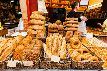 french fancy: Bread counter with a large assortment of fragrant fresh bakery products to the Mahane Yehuda Market in Erusalem. Israel