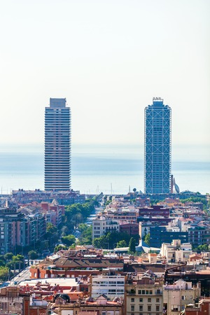 Barcelona Panorama with two high-rise skyscrapers and the sea on the horizon.