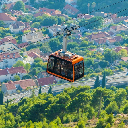 ropeway: Cabin of cableway going up to the mountain near Dubrovnik. Stock Photo