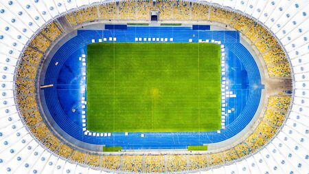 KIEV, UKRINE - JULY 10, 2016: Aerial view of the Olympic Stadium in Kiev. Ukraine. The field for the football game. The largest stadium of city from helicopter. Outdoor.