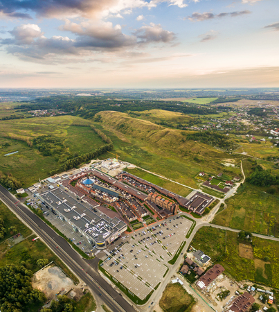 sidewalk sale: New outlet Center of Kiev suburbs in the Dutch style. Ukraine. Aerial view. From above. Top view