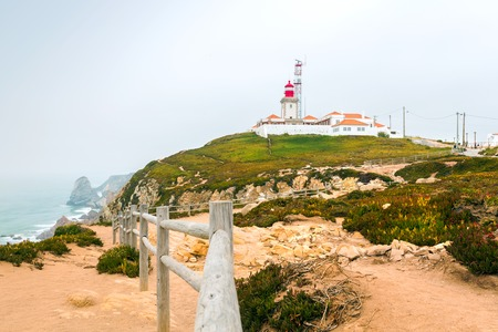 roca: View of the lighthouse and cliff to the ocean, Cabo da Roca, Sintra, Portugal
