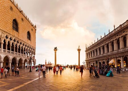 VENICE, ITALY - AUGUST 21, 2016: San Marco square with Doges Palace and Saint Marks Basilica in sunset. The main square of the old town. Venice, Italy.