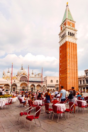 VENICE, ITALY - AUGUST 21, 2016: San Marco square with Campanile and Saint Marks Basilica before the rain. The main square of the old town. Venice, Italy.