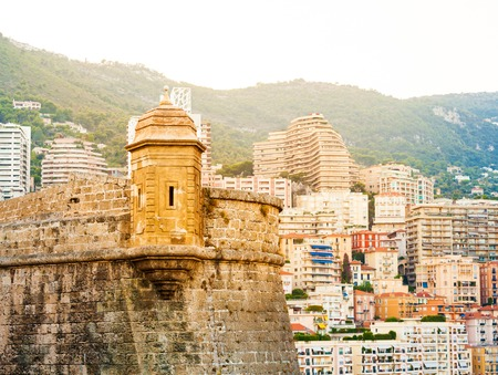 Detail of Princes Palace in Monaco-ville and the city in the background in the evening, Monaco