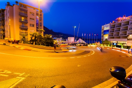 MONTE CARLO, MONACO - AUGUST 27, 2016: The Grand Hotel hairpin is very well known of the Formula 1. Fragment of the road along which the Formula 1 pass through in Monte Carlo at night, Monaco Editorial