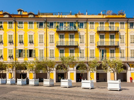 risorgimento: NICE, FRANCE - AUGUST 28, 2016: The yellow building in Garibaldi square. The old town of Nice, France