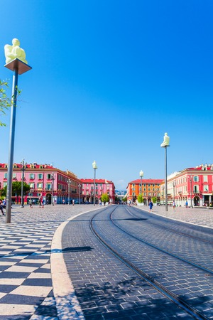 NICE, FRANCE - AUGUST 28, 2016: Place Massena with statues on columns in Nice, France. The place is the most famous of the city because of its beauty, shopping options and the carnival.