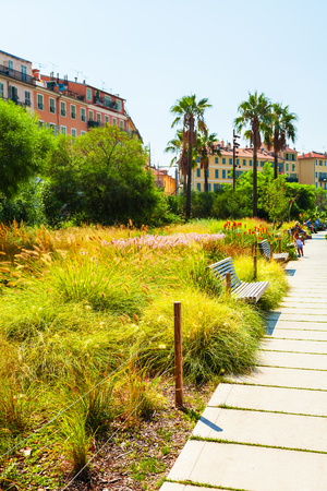 Beautiful park in the old part of Nice. France. Place Massena. Big refreshing green area in the center of Nice