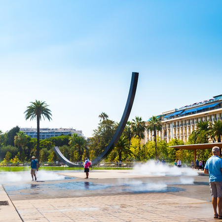 NICE, FRANCE - AUGUST 28, 2016: Place Massena in Nice, France. The place is the most famous of the city because of its beauty, shopping options and the carnival.