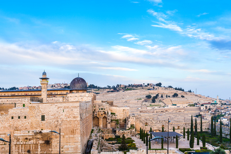 Dung gate of the old city and Al-Aqsa Mosque against the background of Jewish cemetery. Judaism. Jerusalem, Israel.