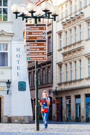 Cute Traveler Girl Searching Right Direction On The Map Standing