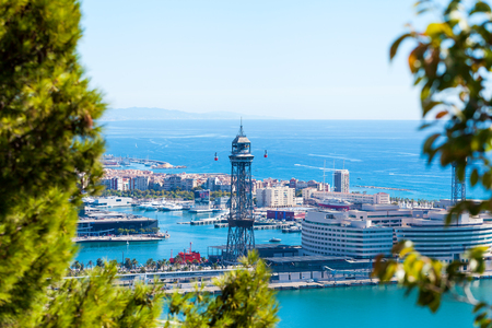 montjuic: Cable car against the background of the city of Barcelona. View from Montjuic mountain to the city and Yacht port. Stock Photo
