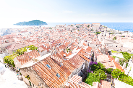 Dubrovnik old town roofs. Aerial view. Cityscape of Dubrovnik with birds eye view. Travel to Croatia. Bleached processing photos