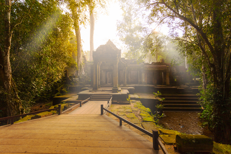 Ancient Ta Prohm Temple in the morning sun rays, Angkor, Cambodia. Ruin Stock Photo