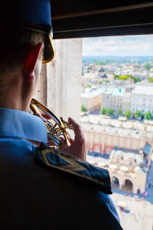 hymn: KRAKOW, POLAND - JULY 14, 2016: Cracovian Hymn played by a trumpeter from the highest tower of St. Marys Church in Krakow, Poland.