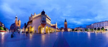 Cloth Hall well known as sukiennice, St. Marys Church and the Clock Tower at night. Panoramic view of Market Square - main square in old city. Krakow Poland.