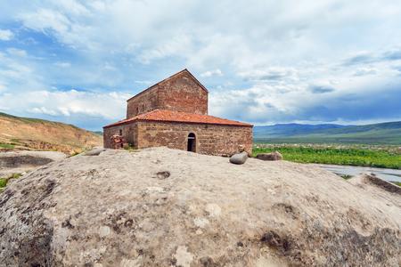 Church Apostoli. The cave city. Uplistsikhe. Georgia. The beautiful age-old building on the rock Stock Photo