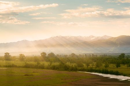 Valley view from the river and the mountains in the background at sunrise. Georgia. Caucasus mountains Stock Photo