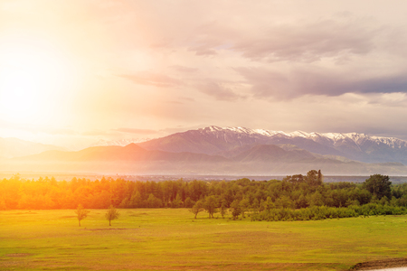 Valley view with mountains in the background at sunrise. Georgia. Caucasus mountains Stock Photo