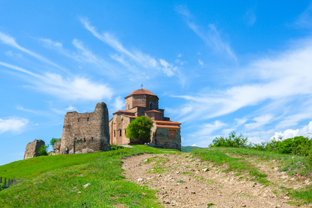 Jvari Monastery - Orthodox church on top of a hill near the town of Mtskheta at the junction of three rivers. It is listed as a World Heritage site by UNESCO. Georgia. Stock Photo