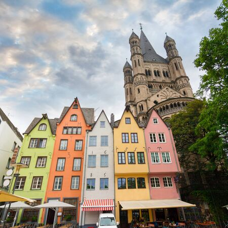 case colorate: Great St. Martin Church and colorful houses of Cologne. Germany.