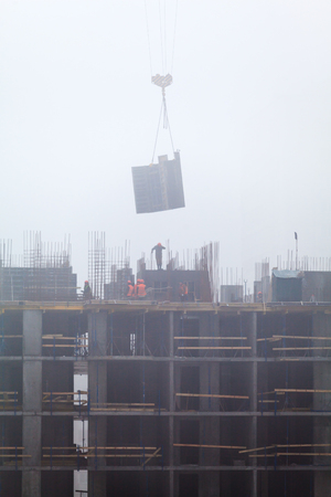 residential: A new residential building under construction in the morning mist. Stock Photo