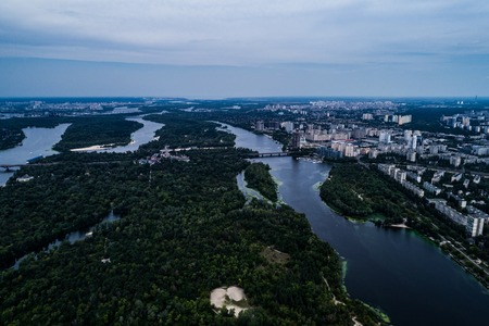 Panoramic view of the city of Kiev with the Dnieper River. A large park area in the middle of the city. Aerial view