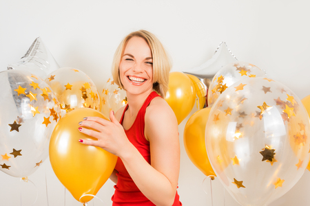 Young happy blonde woman with baloons smiling close up, lifestyle real people concept Stock Photo
