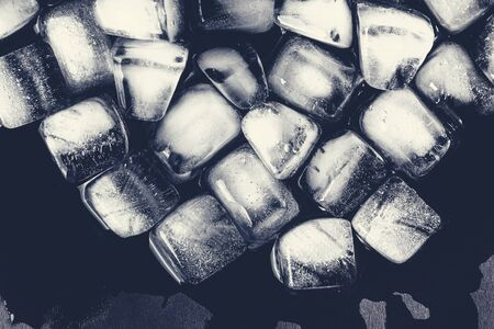 Texture of ice cubes on a dark background