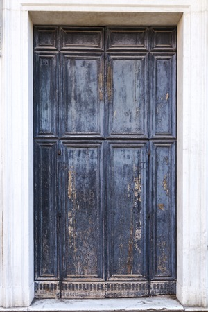 Isolated old door in gray and blue colors.