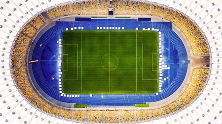 KIEV, UKRAINE - JULY 10, 2016: Aerial view of the Olympic Stadium in Kiev. Ukraine. The field for the football game. The largest stadium of city from helicopter. Outdoor.