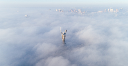 Aerial view of the Monument Motherland, shrouded in thick fog. Historical sights of Ukraine. Banco de Imagens