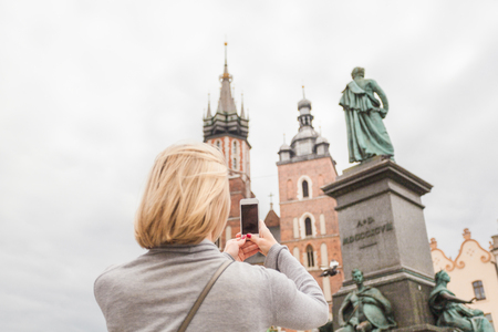 Young beautiful woman on the background of the St. Marys Church in Krakow Stock Photo