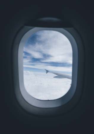 Airplane porthole window during flight