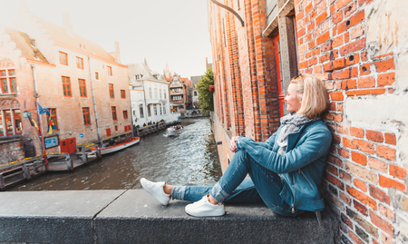 Woman tourist in Bruges. Country Sightseeing, Travel to Belgium