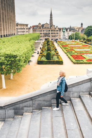 Happy young female student sightseeing in Brussels, Belgium 写真素材