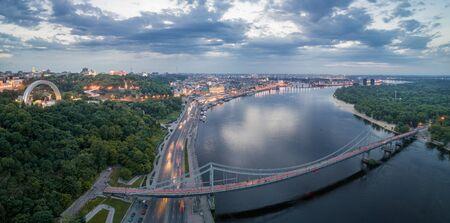 Aerial night view of the city of Kiev near the pedestrian bridge.