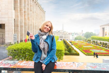 Woman traveler looks at the sights of Brussels, Belgium. Imagens