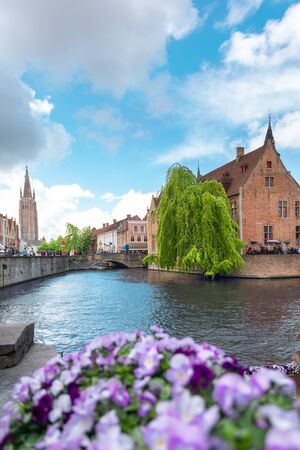 Panoramic city view with Belfry tower and famous canal in Bruges, Belgium. Reklamní fotografie